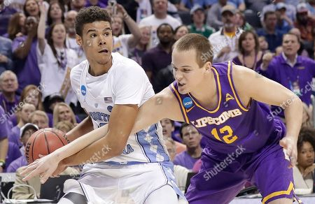 Stock Picture of Matt Rose, Cameron Johnson. Lipscomb's Matt Rose (12) reaches in on North Carolina's Cameron Johnson during the first half of a first-round game in the NCAA men's college basketball tournament in Charlotte, N.C