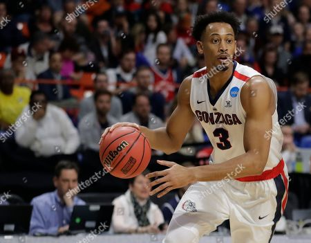 Gonzaga forward Johnathan Williams moves the ball against UNC-Greensboro during an NCAA men's college basketball tournament first-round game, in Boise, Idaho