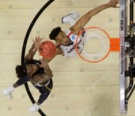 Gonzaga forward Johnathan Williams, right, and UNC-Greensboro forward James Dickey III, left, reach for a loose ball during a first-round game against UNC-Greensboro in the NCAA men's college basketball tournament, in Boise, Idaho. Ohio State won 81-73