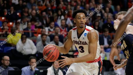 Gonzaga forward Johnathan Williams moves the ball against UNC-Greensboro during the first half of an NCAA college basketball tournament first-round game, in Boise, Idaho