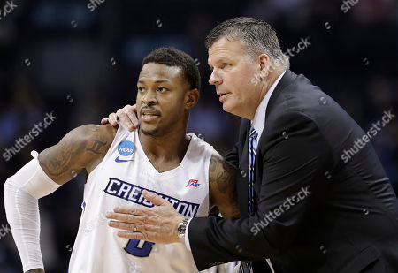 Greg McDermott, Marcus Foster. Creighton coach Greg McDermott, right, talks with Marcus Foster during the second half of the team's first-round game against Kansas State in the NCAA men's college basketball tournament in Charlotte, N.C