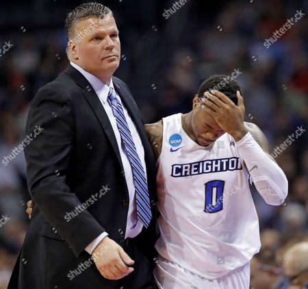 Greg McDermott, Marcus Foster. Creighton's Marcus Foster (0) is consoled by coach Greg McDermott as he leaves the court during the second half of a first-round game against Kansas State in the NCAA men's college basketball tournament in Charlotte, N.C