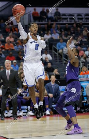 Marcus Foster, Barry Brown. Creighton's Marcus Foster (0) passes the ball past Kansas State's Barry Brown (5) during the first half of a first-round game in the NCAA men's college basketball tournament in Charlotte, N.C