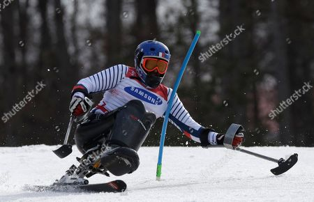 Frederic Francois of France competes in the men's alpine skiing slalom, sitting, at the 2018 Winter Paralympics in Jeongseon, South Korea