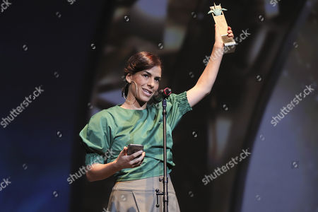 """Mexican actress Daniela Schmidt receives the """"Mezcal"""" award for Best Actress for """"Ocho de cada Diez"""" during the Guadalajara Film Festival, in Guadalajara, Mexico, 16 March 2018. The Peruvian documentary """"Wiñaypacha"""" and """"Matar a Jesús"""", co-production of Colombia and Argentina, rose today as the most winning films of the 33rd edition of the International Film Festival in Guadalajara, which in 2019 will have Chile as guest of honor."""