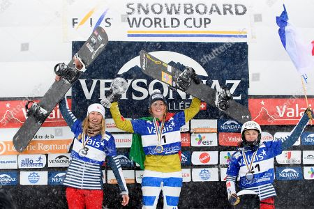 Stock Picture of Snowboard Cross World Cup winner Michela Moioli of Italy, center, celebrates with her crystal globe next to second placed Chloe Trespeuch of France, left, and third placed Nelly Moenne Loccoz of France, right, during the podium ceremony after the women's FIS World Cup Snowboard Cross final race, in Veysonnaz, Switzerland, Saturday, March 17, 2018.
