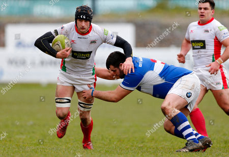 George Mills of Plymouth Albion hands off Sean Edwards of Bishop's Stortford during the National Division 1 match between Plymouth Albion v Bishop's Stortford at the Brickfields Recreation Ground, on March 17th 2018, Plymouth, Devon, UK.