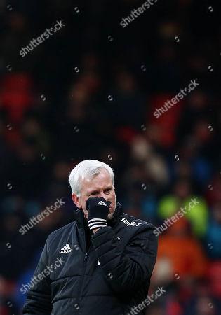 West Bromwich Albion Manager Alan Pardew looks dejected.