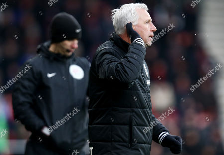 West Bromwich Albion Manager Alan Pardew gestures to his ear.