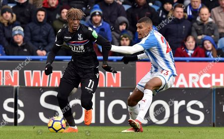 Wilfried Zaha of Crystal Palace and Collin Quaner of Huddersfield Town