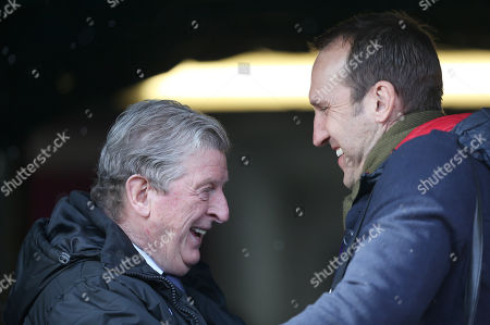 Roy Hodgson Manager of Crystal Palace chats with Former Fulham and Australian goalkeeper Mark Schwarzer ahead of the Premier League match between Huddersfield Town and Crystal Palace on the 17th March 2018 at the John Smith's Stadium, Huddersfield.