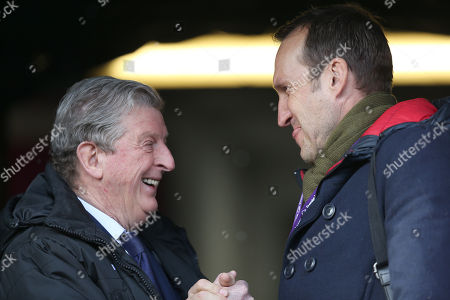 Stock Picture of Roy Hodgson Manager of Crystal Palace chats with Former Fulham and Australian goalkeeper Mark Schwarzer ahead of the Premier League match between Huddersfield Town and Crystal Palace on the 17th March 2018 at the John Smith's Stadium, Huddersfield.