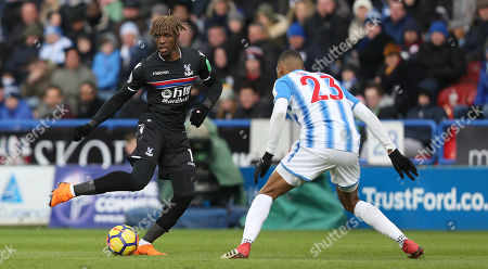 Wilfried Zaha of Crystal Palace takes on Collin Quaner of Huddersfield Town during Premier League match between Huddersfield Town and Crystal Palace on the 17th March 2018 at the John Smith's Stadium, Huddersfield.