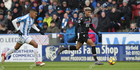 Patrick van Aanholt of Crystal Palace takes on Collin Quaner of Huddersfield Town during Premier League match between Huddersfield Town and Crystal Palace on the 17th March 2018 at the John Smith's Stadium, Huddersfield.