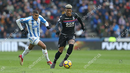 Patrick van Aanholt of Crystal Palace on the ball under pressure from Collin Quaner of Huddersfield Town during Premier League match between Huddersfield Town and Crystal Palace on the 17th March 2018 at the John Smith's Stadium, Huddersfield.