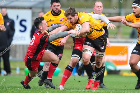 John Stevens of Cornish Pirates pushes away Jacob Perry of Hartpury during the Greene King IPA Championship Match between Hartpury and Cornish Pirates at Gillmans Ground, Hartpurt, Gloucestershire on March 13.