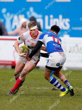 Sam Daly of Plymouth Albion is tackled by Conor Austin of Bishop's Stortford during the National Division 1 match between Plymouth Albion v Bishop's Stortford at the Brickfields Recreation Ground, on March 17th 2018, Plymouth, Devon, UK.