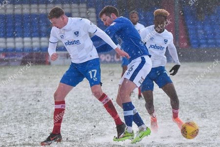 Portsmouth Midfielder, Dion Donohue (17) and Oldham Athletic Midfielder,  Dan Gardner (6)  during the EFL Sky Bet League 1 match between Oldham Athletic and Portsmouth at Boundary Park, Oldham. Picture by Mark Pollitt