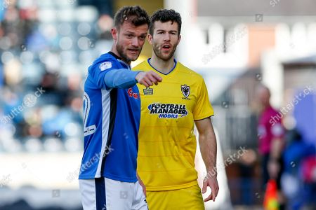 Rochdale defender Scott Wiseman (12), on loan from Chesterfield, marked by AFC Wimbledon defender Jonathan Meades (3)  during the EFL Sky Bet League 1 match between Rochdale and AFC Wimbledon at Spotland, Rochdale. Picture by Simon Davies
