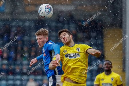 Rochdale midfielder Andy Cannon (27) battles with AFC Wimbledon defender Jonathan Meades (3)  during the EFL Sky Bet League 1 match between Rochdale and AFC Wimbledon at Spotland, Rochdale. Picture by Simon Davies