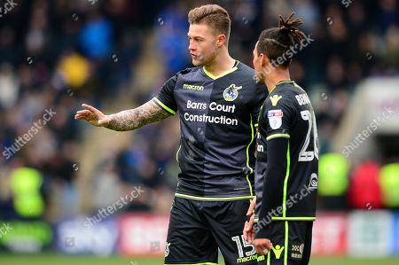 James Clarke of Bristol Rovers speaks with Kyle Bennett