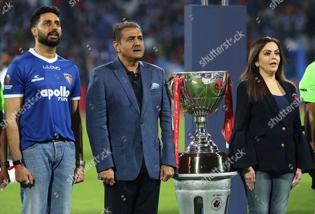 Abhishek Bachchan, Praful Patel, Nita Ambani. Bollywood actor and co-owner of team Chennaiyin FC Abhishek Bachchan, left, Praful Patel, center, president of All India Football Federation and Nita Ambani, founder and chairperson Football Sports Development Limited sing national anthem as they stand next to the winners trophy before the start of the Hero Indian Super League (ISL) soccer final match between Bengaluru FC and Chennaiyin FC in Bangalore, India