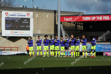 Exeter City players observe a minutes applause for the late Jim Bowen during the League Two match between Morecambe and Exeter City at Globe Arena, on March 17th , Morecambe, Lancashire, England.