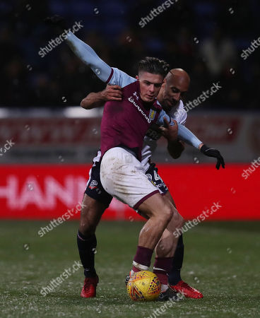 Jack Grealish of Aston Villa and Karl Henry of Bolton Wanderers