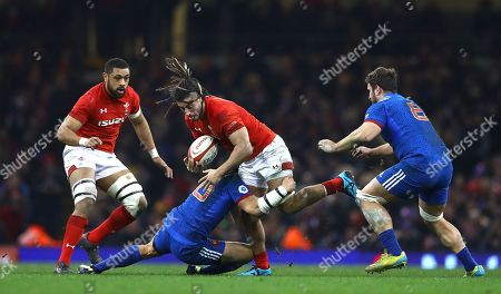 Josh Navidi of Wales is tackled by Francois Trinh-Duc of France
