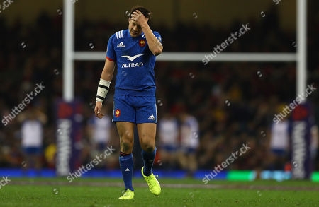 Francois Trinh-Duc of France shows a look of dejection