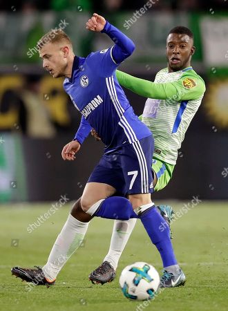 Stock Picture of Schalke's Max Meyer, left, and Wolfsburg's Daniel Didavi, right, challenge for the ball during the German Bundesliga soccer match between VfL Wolfsburg and FC Schalke 04 in Wolfsburg, Germany