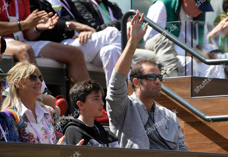 Former tennis player Pete Sampras waves to fans during the semifinals between Roger Federer, of Switzerland, and Borna Coric, of Croatia, at the BNP Paribas Open tennis tournament, in Indian Wells, Calif