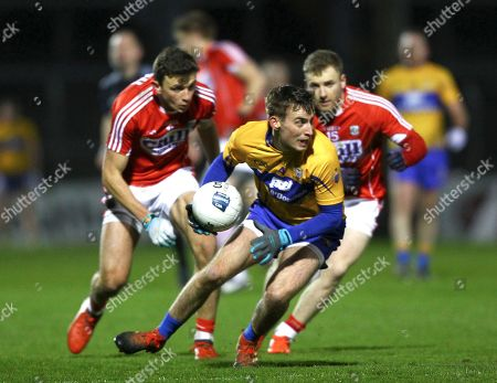 Cork vs Clare. Clare's Eoghan Collins in action against Cork's Michael Hurley and Mark Collins