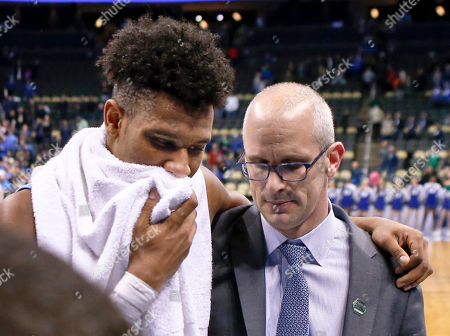 E.C. Matthews, Dan Hurley. Rhode Island's E.C. Matthews, left, puts an arm around head coach Dan Hurley as they leave the court after losing to Duke in a second-round game in the NCAA men's college basketball tournament, in Pittsburgh. Duke won 87-62