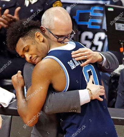 Dan Hurley, E.C. Matthews. Rhode Island's E.C. Matthews (0) hugs coach Dan Hurley at the end of an NCAA men's college basketball tournament second-round game against Duke in Pittsburgh, . Duke won 87-62