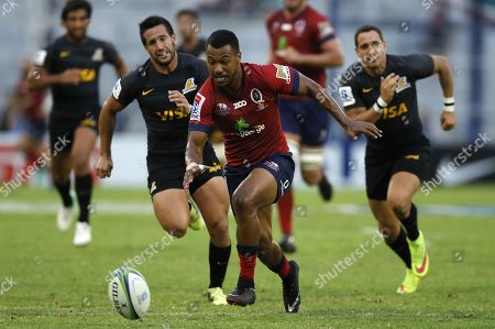 Jaguares' Santiago Gonzalez (L-BACK) vies for the ball with Reds' Aidan Toua (C) during the Super Rugby league match played at Jose Amalfitani Stadium in Buenos Aires, Argentina, 17 March 2018.