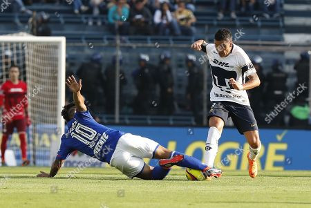 Cruz Azul's Walter Montoya (L) fights for the ball with Pumas' Pablo Barrera (R), during their Mexican Tournament match at the Azul stadium in Mexico City, Mexico, 17 March 2018.