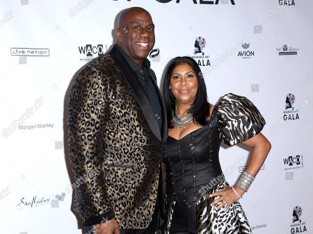 Magic Johnson, Cookie Johnson. Magic Johnson, left, and Cookie Johnson arrive at the 2nd Annual Wearable Art Gala at The Alexandria Ballrooms, in Los Angeles