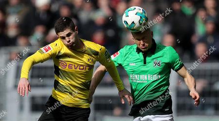 Dortmund's Christian Pulisic (L) in action against Hannover's Matthias Ostrzolek (R) during the German Bundesliga soccer match between Borussia Dortmund and Hannover 96, in Dortmund, Germany, 18 March 2018.