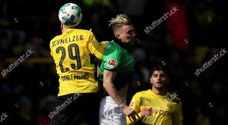 Hannover's Matthias Ostrzolek (C) in action against Dortmund's Marcel Schmelzer (L)  during the German Bundesliga soccer match between Borussia Dortmund and Hannover 96, in Dortmund, Germany, 18 March 2018.