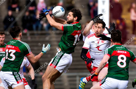 Mayo vs Tyrone. Mayo's Tom Parsons and Tyrone's Colm Cavanagh