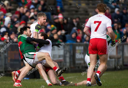 Mayo vs Tyrone. Mayo's Tom Parsons is pulled to the ground by Tyrone's Colm Kavanagh earning the Tyrone man a black card