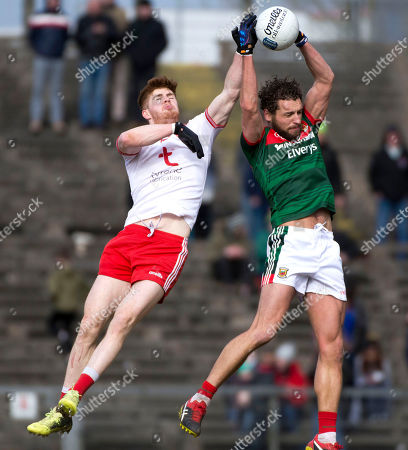 Mayo vs Tyrone. Mayo's Tom Parsons and Tyrone's Cathal McShane