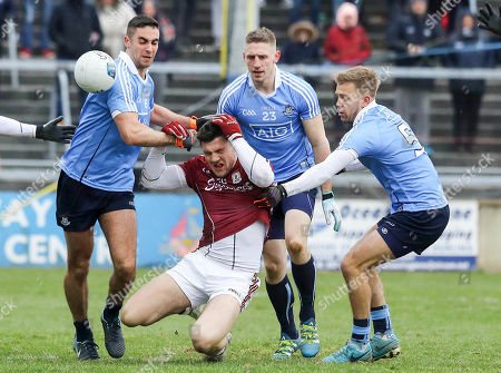 Galway vs Dublin. Galway's Damien Comer tackled by James McCarthy and John Cooper of Dublin