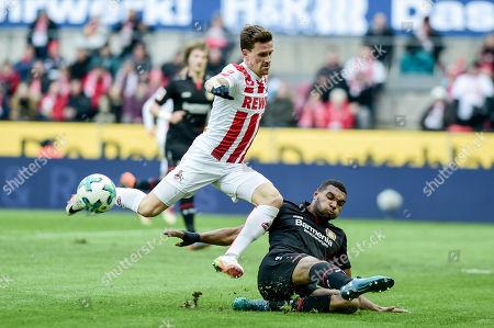 Football : Germany -1. Bundesliga  2017/18  1. FC Koeln vs Bayer Leverkusen 04 18/03/2018 -Simon Zoller (1. FC Koeln), Jonathan Tah (Bayer 04 Leverkusen) during the game at the RheinEnergie Stadium, Koeln.