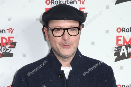 Stock Image of Director Matthew Vaughan poses for photographers at the Empire Film Awards in London