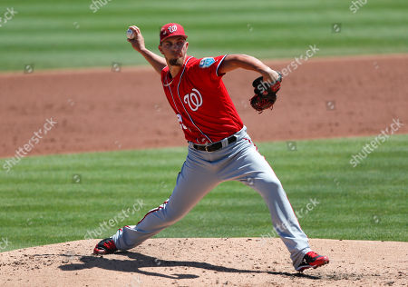 AJ Cole. Washington Nationals starting pitcher A.J. Cole works in the second inning of a spring training baseball game against the St. Louis Cardinals, in Jupiter, Fla