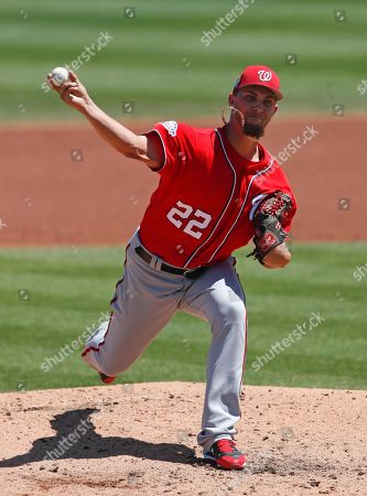 AJ Cole. Washington Nationals starting pitcher A.J. Cole (22) work against the St. Louis Cardinals in the second inning of a spring training baseball game, in Jupiter, Fla