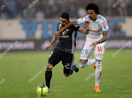 Rafael Da Silva, Luiz Gustavoo. Lyon's Rafael Da Silva, left, challenges for the ball with Marseille's Luiz Gustavo, during the League One soccer match between Marseille and Lyon at the Velodrome stadium, in marseille, southern France