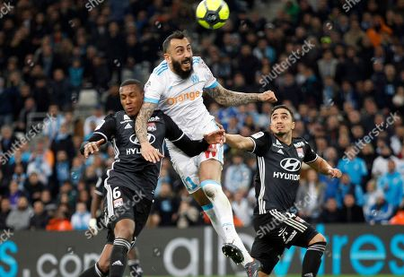Konstantinos Mitroglou, Marcelo, Rafael Da Silva. Marseille's Konstantinos Mitroglou, center, challenges for the ball with Lyon's Marcelo, left, and Rafael Da Silva during the League One soccer match between Marseille and Lyon at the Velodrome stadium, in marseille, southern France